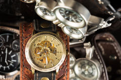 Unusual watches. several alternatives dials. Wide leather bracelet Stock Images