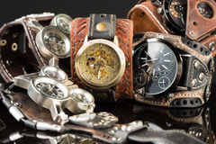 Unusual watches. several alternatives dials. Wide leather bracelet Stock Image
