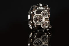 Unusual watches. several alternatives dials. Wide leather bracelet Stock Photo