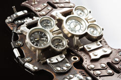 Unusual watches. several alternatives dials. Wide leather bracelet Royalty Free Stock Photo