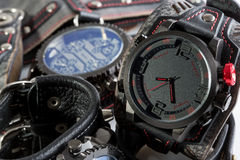 Unusual watches. several alternatives dials. Wide leather bracelet Royalty Free Stock Photography