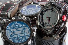 Unusual watches. several alternatives dials. Wide leather bracelet Stock Photos