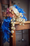 Unusual wedding bouquet with blue feathers Royalty Free Stock Image