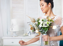 Unusual wedding bouquet at hands of a bride Stock Image