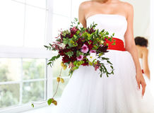 Unusual wedding bouquet at hands of a bride Royalty Free Stock Photo
