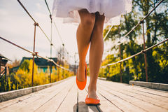 Unusual wedding shoes on the feet of the bride Stock Image
