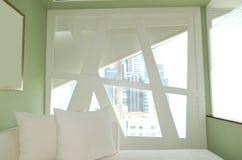 Unusual window in apartment of the luxury hotel Stock Photos