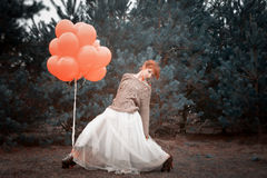 Unusual woman with balloons as concept outdoors Royalty Free Stock Image