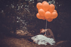 Unusual woman with balloons as concept outdoors Stock Photos