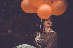 Unusual woman with balloons as concept outdoors Royalty Free Stock Images