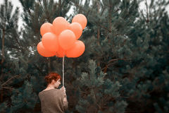 Unusual woman with balloons as concept outdoors Stock Images