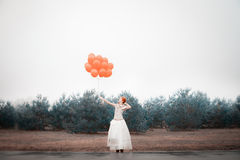 Unusual woman with balloons as concept outdoors Royalty Free Stock Photos