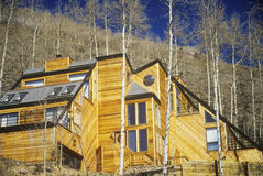 Unusual wood home with solar panels,  Vail, CO Stock Photo