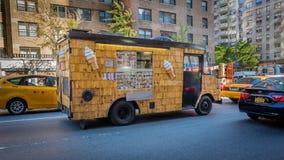 Unusual wood shingles clad ice cream van in New York City Royalty Free Stock Image