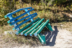 Unusual wooden bench handmade in a forest glade Royalty Free Stock Photo