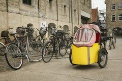Unusual yellow bicycle Stock Photos