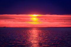 An unusually beautiful fire sunset by the sea. Sunset on the Gulf. Sunset at the sea. royalty free stock photos