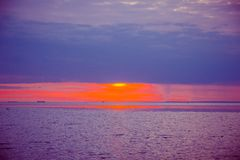 An unusually beautiful fire sunset by the sea. Sunset on the Gulf. Sunset at the sea. royalty free stock images