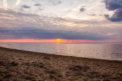 An unusually beautiful fire sunset by the sea. Sunset on the Gulf. Sunset at the sea. stock photos