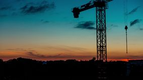 Unusually beautiful sunset on the background of a crane stock video