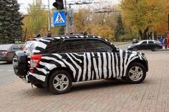 Unusually colored car. Donetsk, Ukraine - October 28, 2010. Colored zebra Suzuki Grand Vitara parked on the sidewalk Stock Image