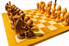 Unusually placed on a board chess pieces Stock Photography