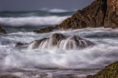 The Unveil. Glass Beach in Fort Bragg, California. Long exposure of the waves off the rocky coastline stock photography