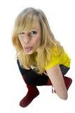 Unverschämte blonde Frau, die heraus Zunge haftet Lizenzfreies Stockfoto