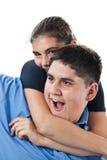 Unverschämte Geschwister Stockbilder