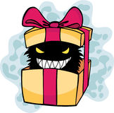 Unwanted Gift. A monster in a box representing an unwanted gift given in a gift exchange Royalty Free Stock Photo