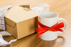 Unwanted gift, cup. Unwanted gift, a white cup Stock Image