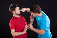 Unwanted men's fight Royalty Free Stock Images