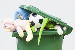 Unwanted toys. A closeup of unwanted toys in a dustbin Royalty Free Stock Photos