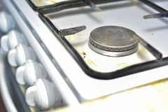 Unwashed gas stove. The concept of care and maintenance of gas appliances royalty free stock image