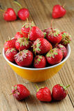 Unwashed strawberries in bowl Royalty Free Stock Photo