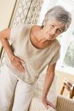 чувствуя unwell женщина Стоковая Фотография RF