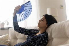 Free Unwell Asian Girl Feel Overheated Wave Using Hand Fan Stock Images - 191765024