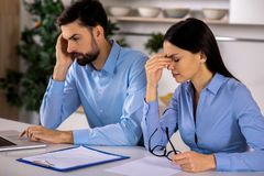 Unwell business colleagues feeling tired after work royalty free stock photography