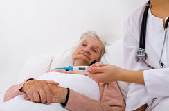 Unwell elderly woman Stock Photos