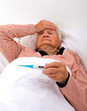 Unwell elderly woman Stock Photography