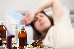 Unwell patient lying down bed Royalty Free Stock Photo