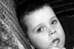 Unwell sick child laying on pillow.  Royalty Free Stock Photo