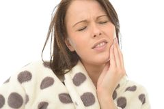 Unwell Sick Poorly Young Woman With A Painful Toothache. Unwell Sick poorly Young Woman, in her twenties,  With a painful Toothache, Holding Her Face With Her Royalty Free Stock Images
