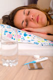 Unwell woman. Unwell beautiful woman laying in the bed Royalty Free Stock Photos