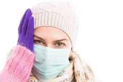 Unwell woman holding her head because of flu virus stock image