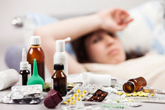 Unwell woman patient lying down bed Stock Photography