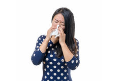 Unwell young Chinese woman blowing her nose Royalty Free Stock Photo