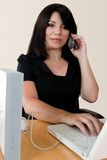 Unwired. A woman making a wireless internet phone call via a wirless modem router Stock Photos