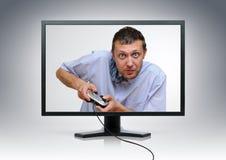 Unwirkliches Büroangestellter gamer von der Bildschirmanzeige Stockfotos