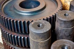 Unworked gears and shafts in the shop. At the factory Royalty Free Stock Images